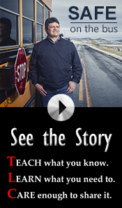 man standing in front of school bus